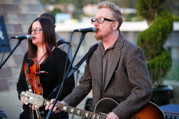 HOLLYWOOD, CA - MARCH 08: Bridget Regan (L) and Dave King of Flogging Molly perform at 98.7 FM's Penthouse Party Pad at The Historic Hollywood Tower on March 8, 2012 in Hollywood, California. (Photo by Imeh Akpanudosen/Getty Images)